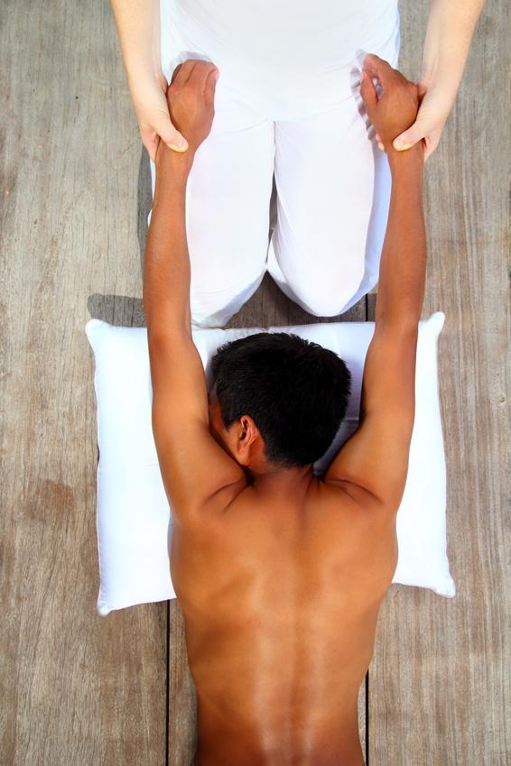 massage therapy stretch shiatsu on wooden floor