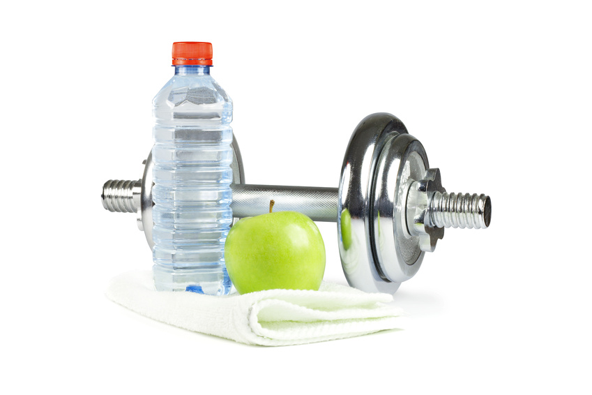 Dumbell, bottle, towel and green apple